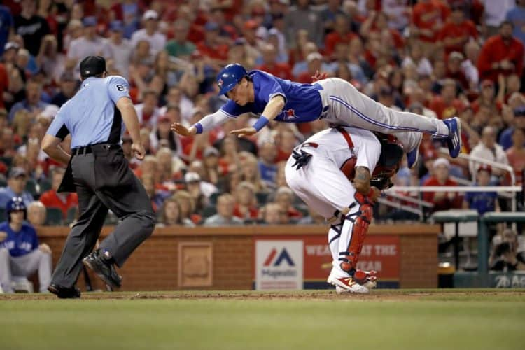 jumping over catcher to score