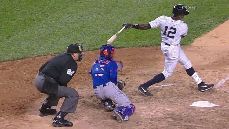 batter hits catcher on back swing